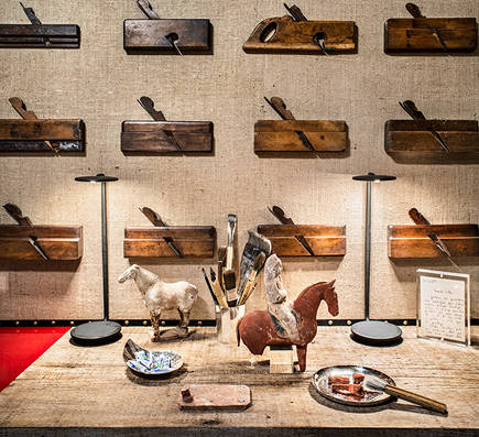 displayed collection of antique carpentry tools