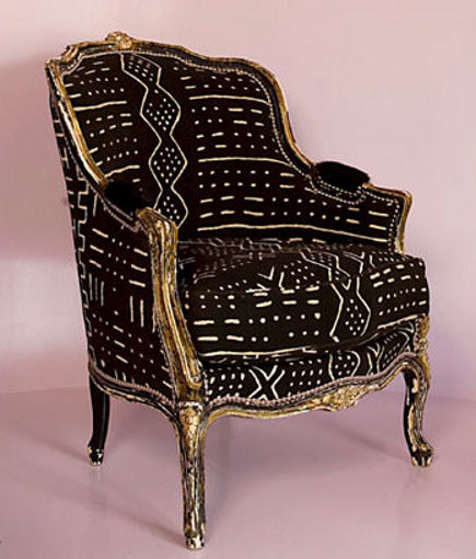 bold upholstery fabric - gilded bergere upholstered in Malian mud cloth - maison boheme via atticmag