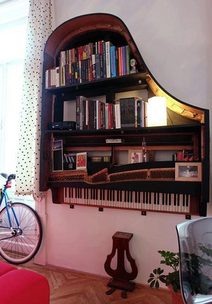 vintage piano repurposed into wall mounted bookshelves