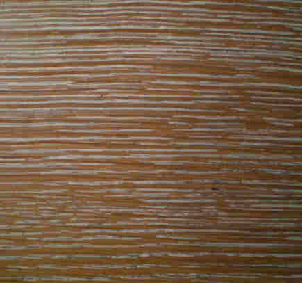 close up of a limed oak table by Jean-Michel Frank