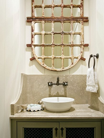 repurposed ornamental iron window grilles into bathroom mirror by Amy D Morris Interiors