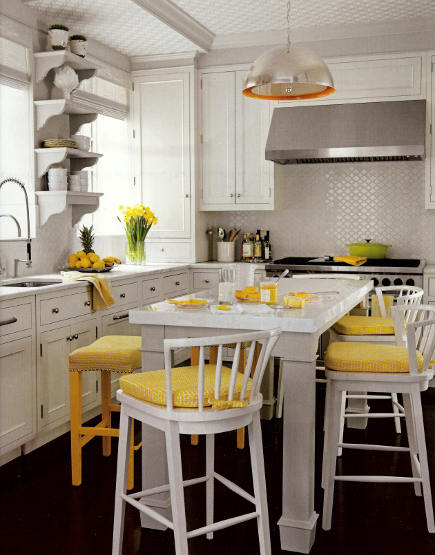 white kitchen with tone-on-tone wallpaper on the ceiling and a similar backsplash - House Beautiful via Atticmag