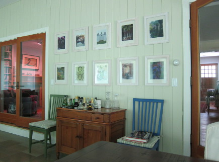 dining room with magazine page picture wall