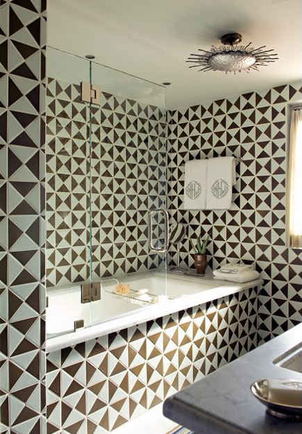 Brown and white triangle shape tile bath - Cathy Kincaid via Atticmag