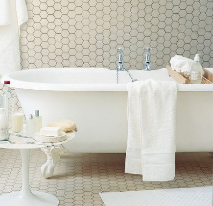 all over tiling - White bathroom with hex tile on walls and floor - house and home via Atticmag