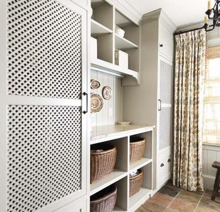 hidden laundry appliances - custom cabinets conceal laundry appliances - Revival Construction via Atticmag