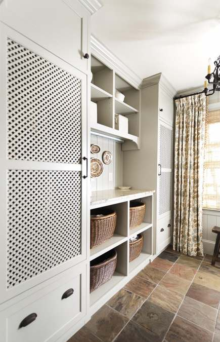 hidden laundry appliances - custom cabinets conceal laundry appliances - Revival Construction via Atticmag