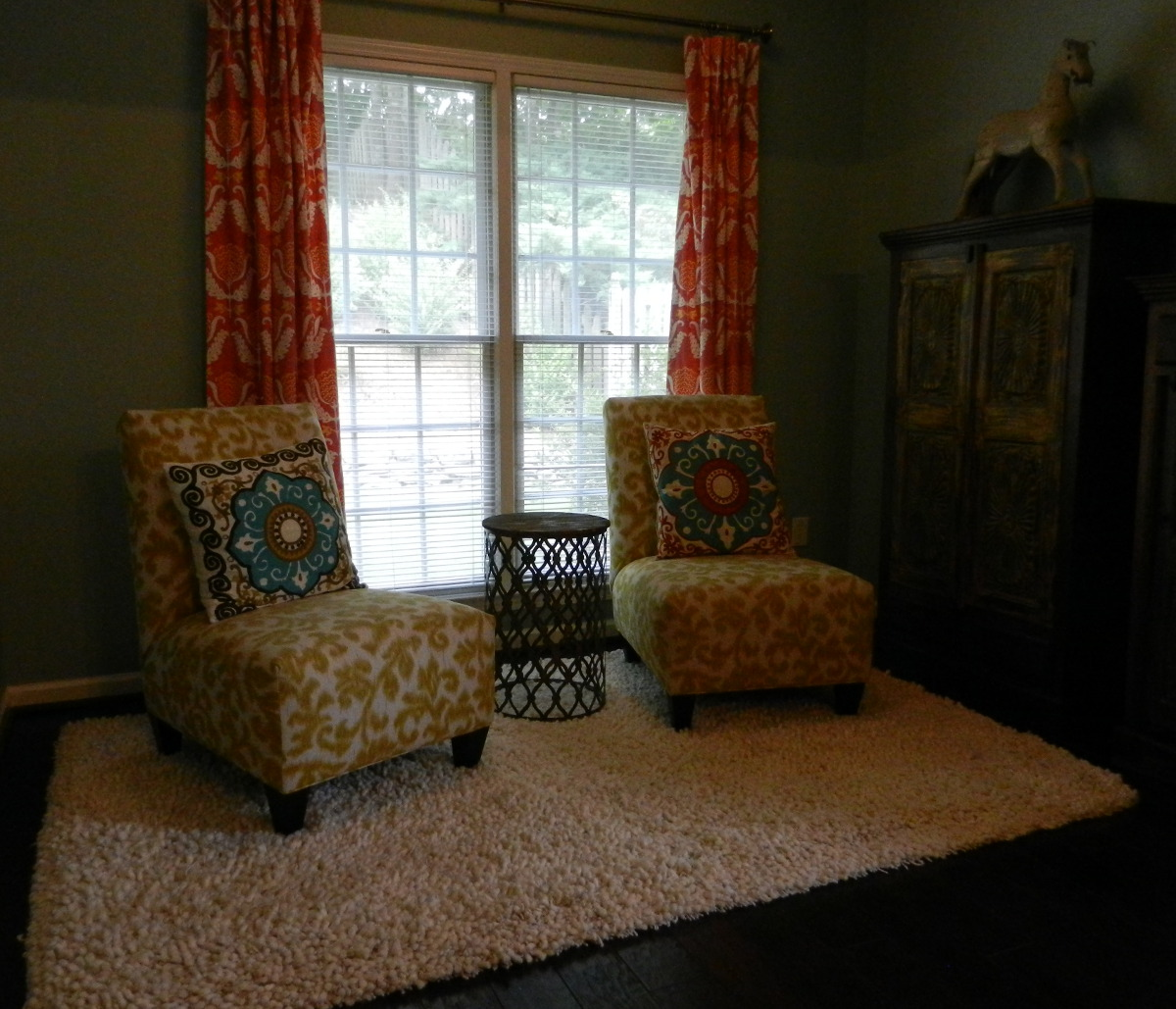 master bedroom decorating ideas - yellow ikat upholstered slipper chairs - Atticmag