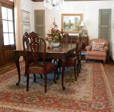 antique walnut dining room with Kalaty soumak rug