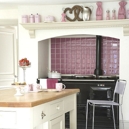 kitchen with mauve ceramic tile range guard with a black Aga - housetohome via Atticmag