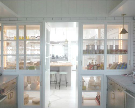 pie safe pantry wall in beach house kitchen - Sardar Design via Atticmag