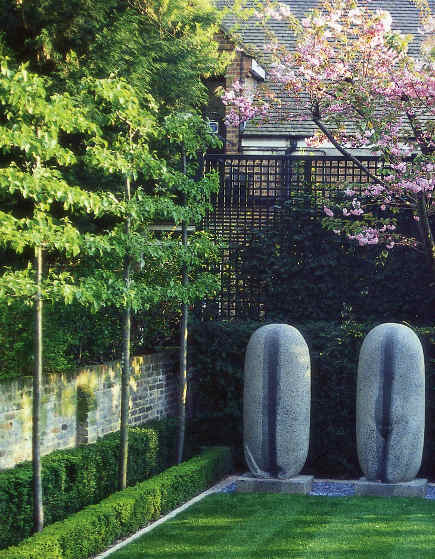 English garden by Luciano Giubbielei with horizontal espalier trees - via Atticmag