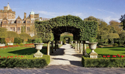 hedge walls and topiaries - formal gardens at Holker Hall - H&G via Atticmag