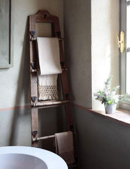 Custom towel racks combine the decorative and practical in the bathroom