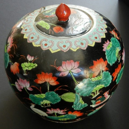 orange home decor - Chinese famille noire covered jar - indulgy via atticmag