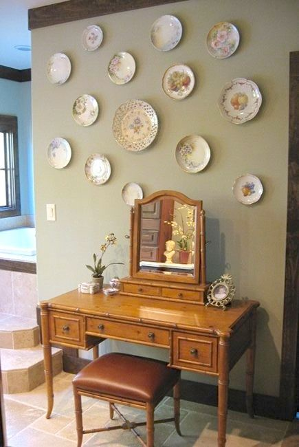 bathroom picture wall - collection of hand painted plates via Atticmag