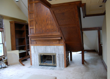 old fireplace and loft stairway in attic prior to renovation - Atticmag