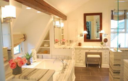 Vermont marble master bath with tub, double vanities and dressing table in renovated attic master suite - Atticmag