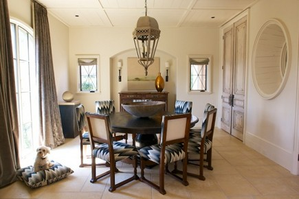 dining room with interior round window from Style Blueprint via Atticmag