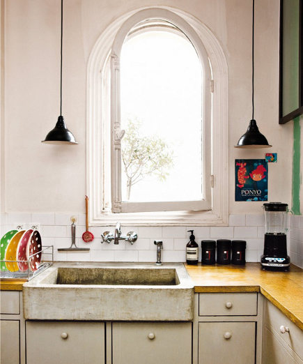 shallow stone sink in a Paris kitchen - pinterest via atticmag