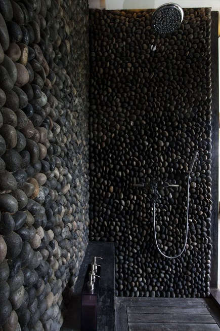 black volcanic stone shower - Architizer via Atticmag