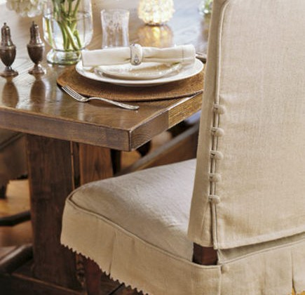 dining chair slipcovers - linen-slipcovered dining chair with button detail - duispy via Atticmag