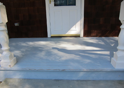 weathered and flaking front porch floor - Atticmag