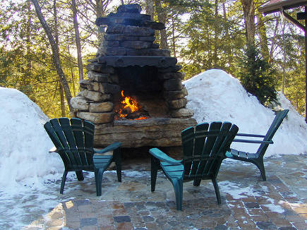 outdoor stone fireplace - flickr via Atticmag