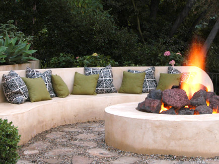 round concrete outdoor fireplace - Jeff Andrews Design via Atticmag