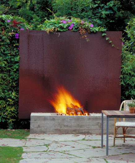 architectural outdoor fireplace with cor-ten steel back guard - houzz via Atticmag