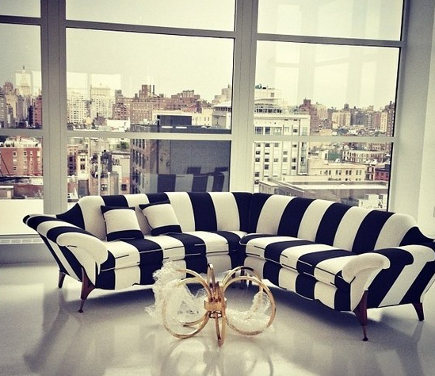 Black and white stripe sectional sofa in the Alice + Olivia showroom – sukio.com via Atticmag