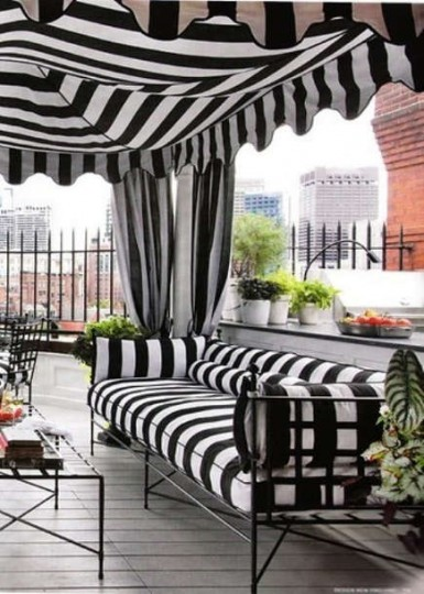 Black and white awning stripe outdoor tent on an urban terrace – theaestate via Atticmag