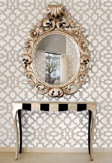 Black and white vertical striped table base on a rococo table – Cutting Edge Stencils via Atticmag