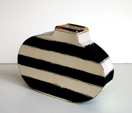 Black and white striped flower vase with 22 k gold lustre- etsy via Atticmag