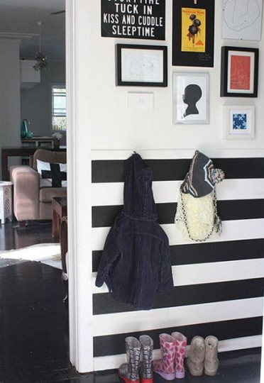 Black and white horizontal striped wainscot wall in an apartment – freshhome via Atticmag
