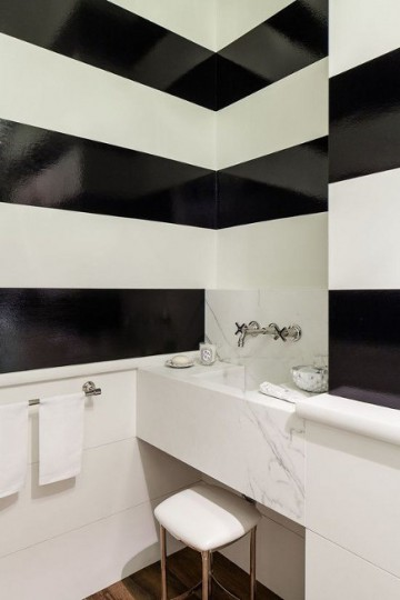 black and white stripe ideas - Black and white horizontal glossy stripes in a minimalist bathroom – Chambers and Chambers via Atticmag