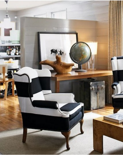 Black and white striped wing chairs upholstered with pieced Sunbrella fabric – Martha Stewart Living via Atticmag