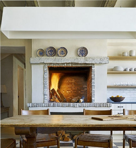 wood burning fireplace in a rustic kitchen - David Michael Miller via Atticmag