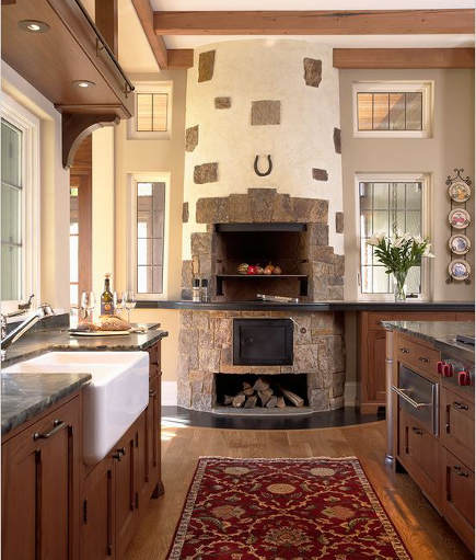 wood burning fireplace in a Minnesota lake house kitchen - tea2 architects via Atticmag