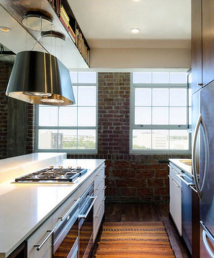 Elica twin vent hood in Houston loft with open kitchen - Build-Content via Atticmag