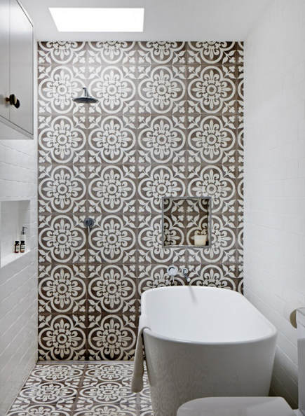 large-scale pattern cement tiles used on a bathroom wall and floor - clippings.com via Atticmag