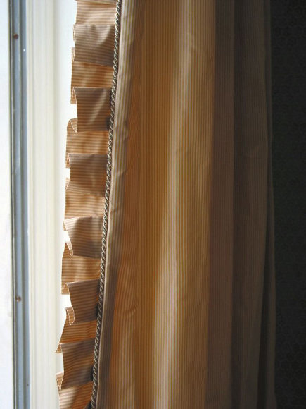silk curtains with box-pleat ruffle and cording - about.com via atticmag