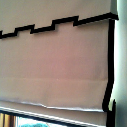 white roman shade with black edges and notched valance - Grant K. Gibson via Atticmag