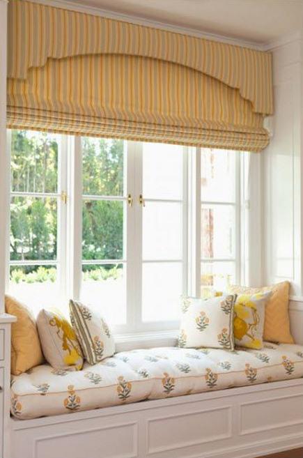 yellow striped roman shade beneath a matching upholstered cornice - Elizabeth Dinkel via Atticmag
