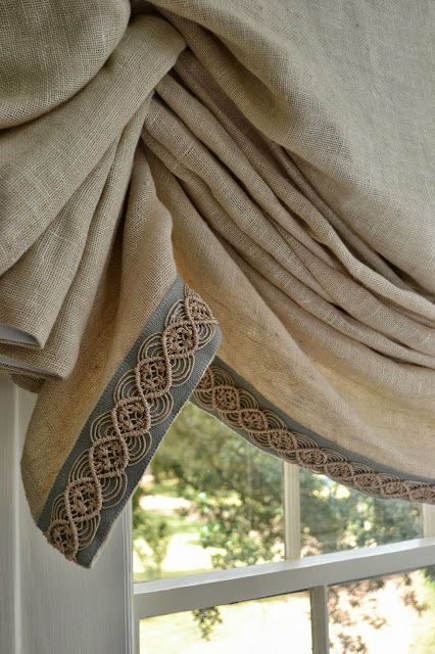 linen London roman shade with raffia band border and top - lucy williams interior design via atticmag