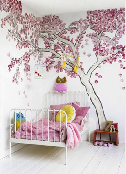 girls room with cherry blossom wall mural and pink bedding - via atticmag