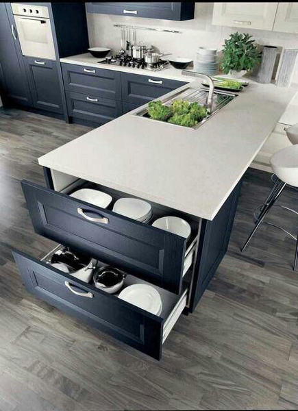 kitchen cabinet drawers on end of a Devon cabinet island - dreamdesign mavens via atticmag