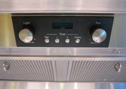 spring cleaning - in the kitchen don't overlook vent hood light and fan control knobs - atticmag