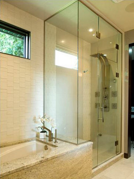 bathroom with Graff ski shower system - centennial renovation studio via atticmag