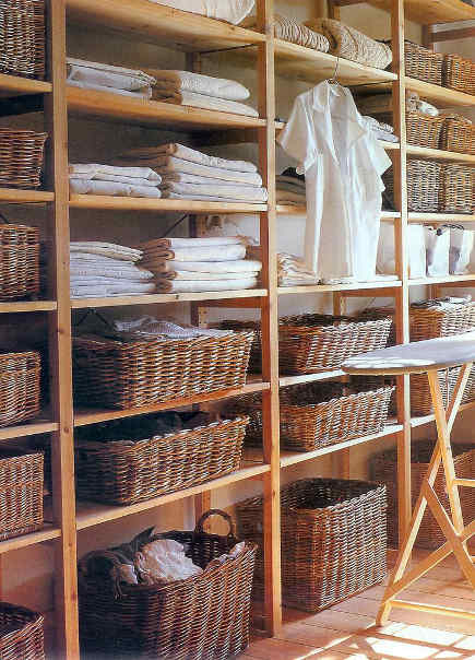 linen closet organization - open shelves and basket storage - pinterest via atticmag